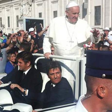 Pope in the popemobile in the middle of the crowd during papal audience