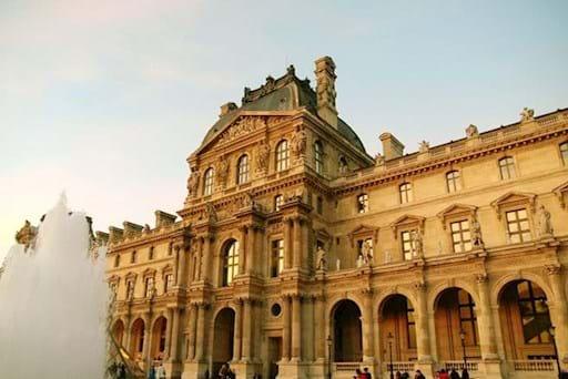 Louvre Museum facade sunset