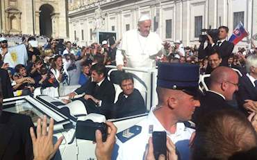 Pope Francis on the car