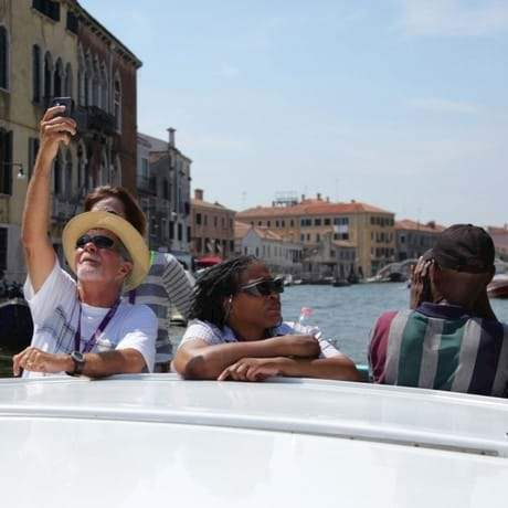 people on a water taxi in Venice