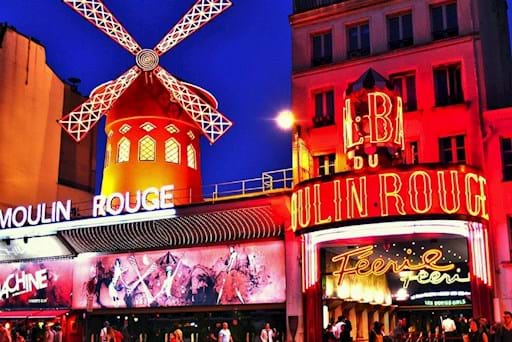 Moulin Rouge at Night with Neon Lights