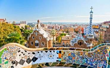 Park Guell Barcelona entrance with colorful mosaic building designed by Antonio Gaudi