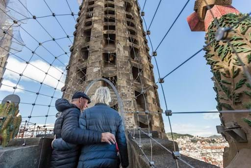 Tourists admiring the view from Sagrada Familia Tower in Barcelona