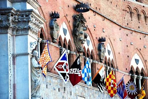 Close-up view of a medieval building in Piazza del Campo