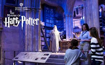 Children listening to tour guide at the Making of Harry Potter Warner Brothers Studio Tour in London