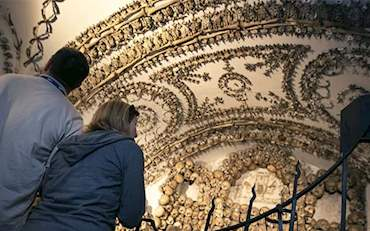 Couple admiring the crypts and catacombs of Rome