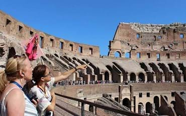 Tourists on a guided tour admiring the architecture of the Colosseum