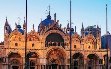 St. Marks Basilica facade at evening time in Venice
