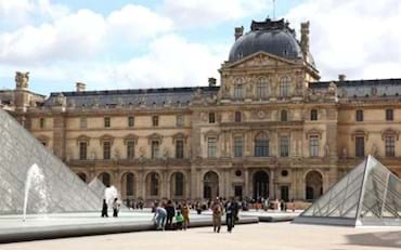 Louvre Museums front view with the famous pyramids