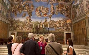 Small group with guide in Sistine Chapel at the Vatican Museums in Rome