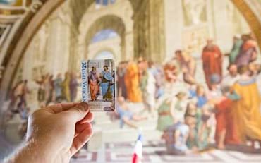 Man holding Vatican ticket in Raphael Rooms