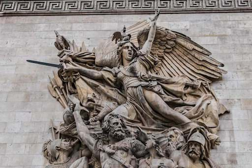 Detailed view of one of the sculpture stuck in the wall of the Arc de Triomphe