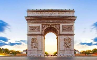 Beautiful sunset looking at the Arc de Triomphe in Paris