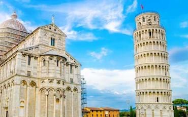 View of the Basilica and the Leaning Tower on Piazza dei Miracoli in Pisa