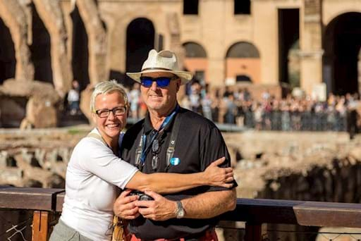Beautiful couple taking a picture inside the Colosseum