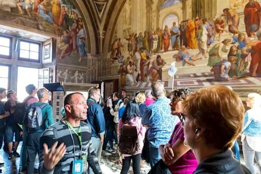 Tourists visiting the Raphael Rooms