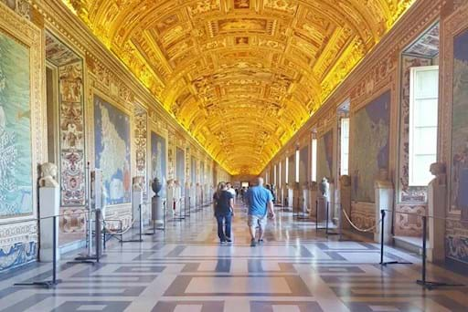 Tourists walking inside the Vatican museums