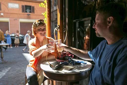 Couple enjoying a soft drink during their tour break