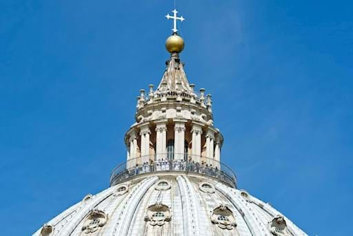 Tourists admiring the view at St. Peter's Basilica Dome in the Vatican