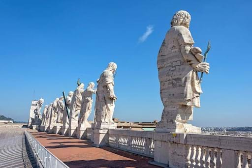 12 apostles statues on the St. Peter's Basilica Facade seen by the Basilica's rooftop