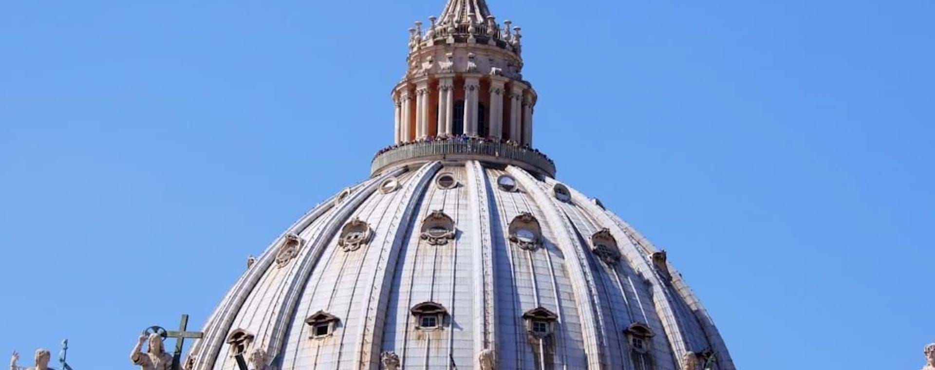 St Peter's Basilica Dome and Apostles statues on a sunny day