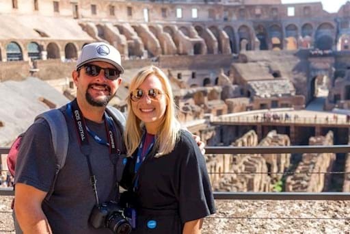Happy couple taking a picture inside the Colosseum
