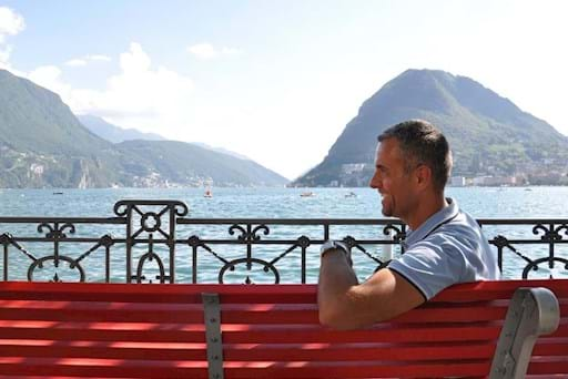 tourist enjoying the view of the Lugano Lake