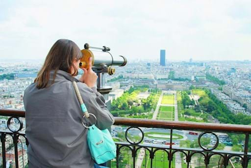 Tourist enjoying the view from the top of the Eiffel Tower