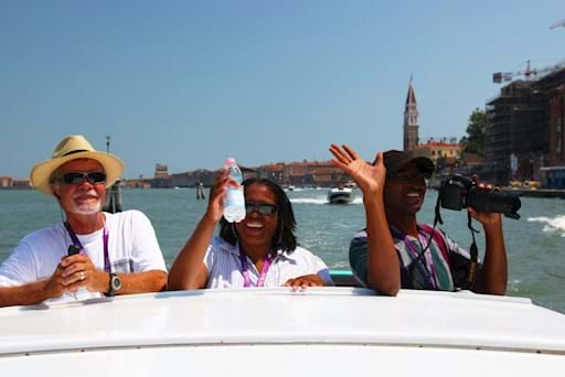Tourists going around venice on a Water Taxi
