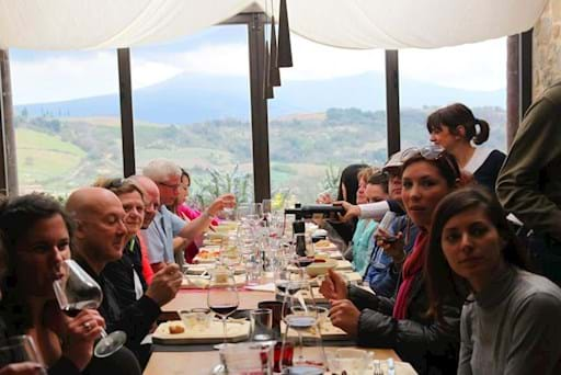 Tourist enjoying their meal in the tuscany countryside