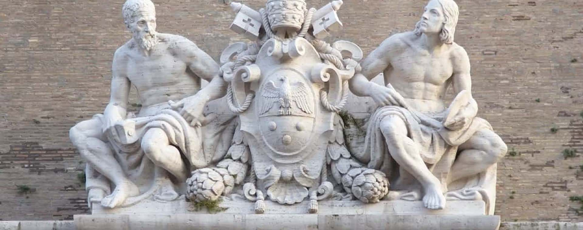 Statues on top of the entrance of the Vatican Museums