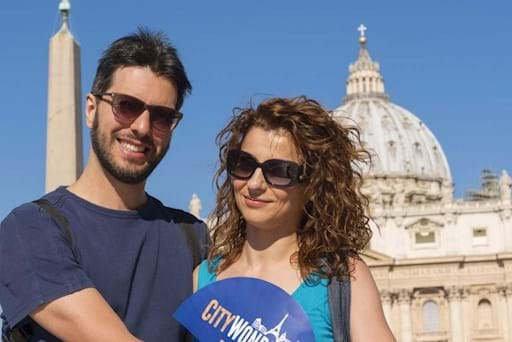 Beautiful couple taking a picture in front St Peter Basilica