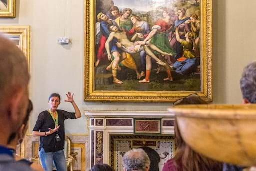 Tour Guide explaining a painting inside the Borghese Gallery