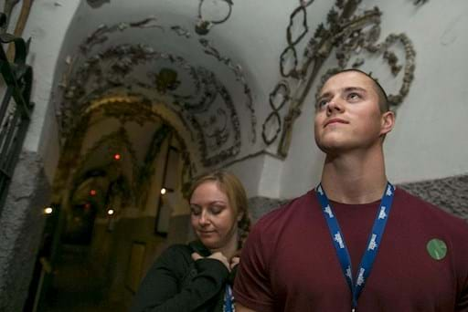 Couple visiting the Capuchin Crypts in Rome