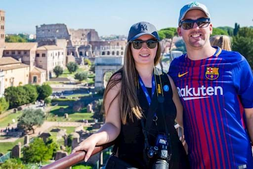 beautiful couple taking a picture in front the Colosseum