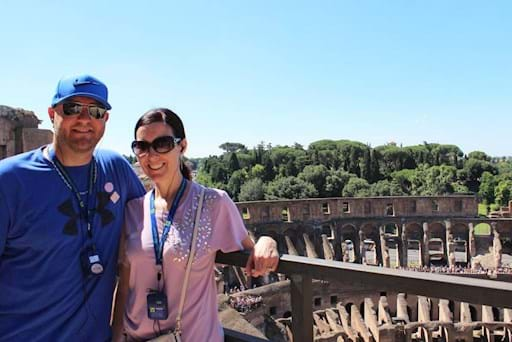 beautiful couple taking a picture in inside the Colosseum