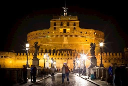 view of Castel Sant' Angelo from bridge of Angels at night