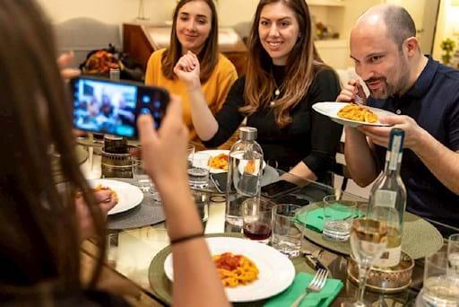 people eating pasta and having fun