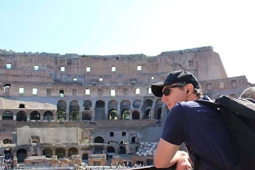 Tourist admiring the Colosseum from the Inside