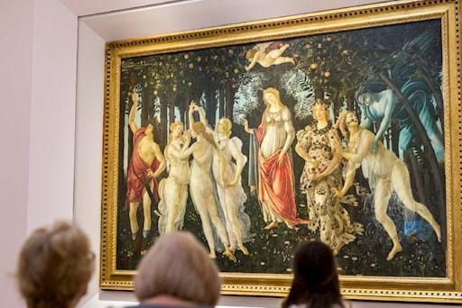 people admiring the beautiful painting of Botticelli's-Spring