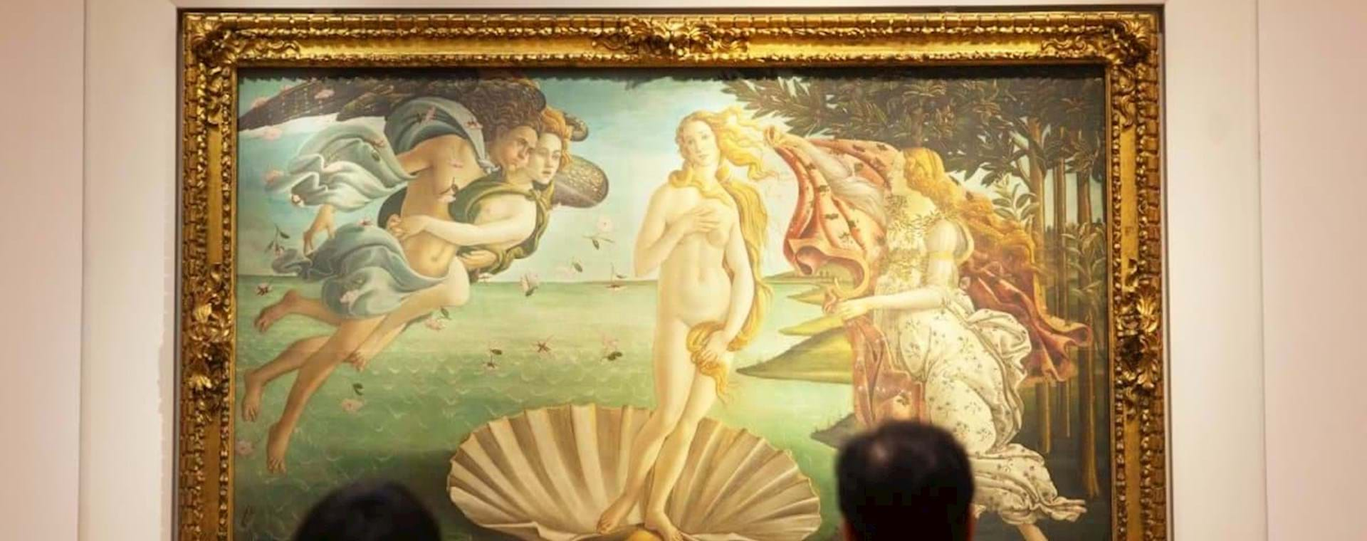 people admiring the beautiful painting of the Birth of Venus