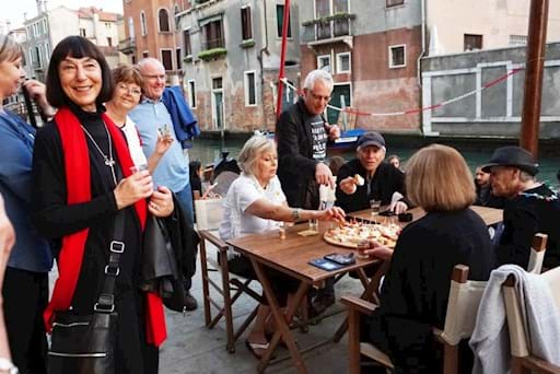 Tourists tasting chichetti and some wine