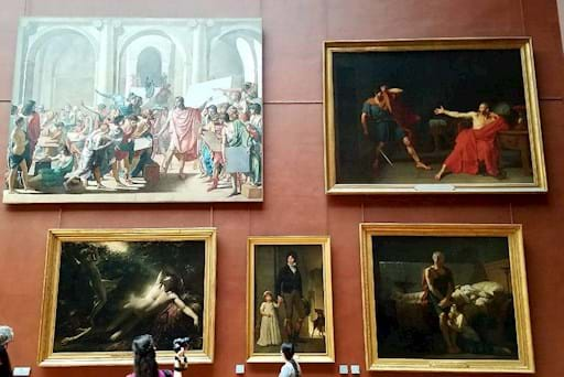 Gallery with some paintings in the louvre