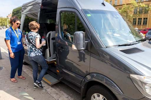 Guests entering on a van to go to Park Guell in Barcelona