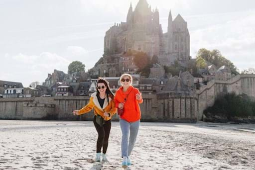 Girls running on the Beach of Mont Saint Michel