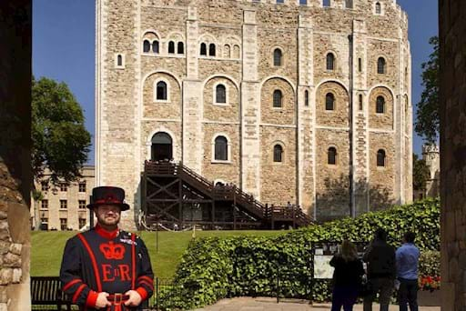 Beefeater in front the Tower of London