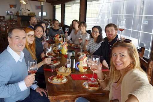 tourists enjoying food and wine near Naples