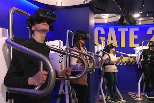 Customers using the Virtual Reality Platforms at the FlyView store in Paris