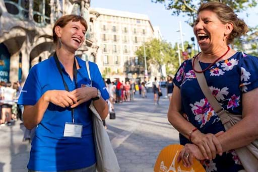 tourist laughing with a tour guide