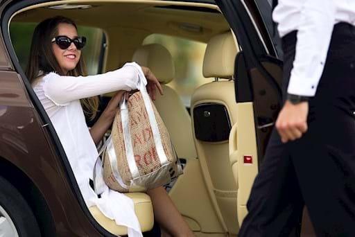 girl inside luxury car